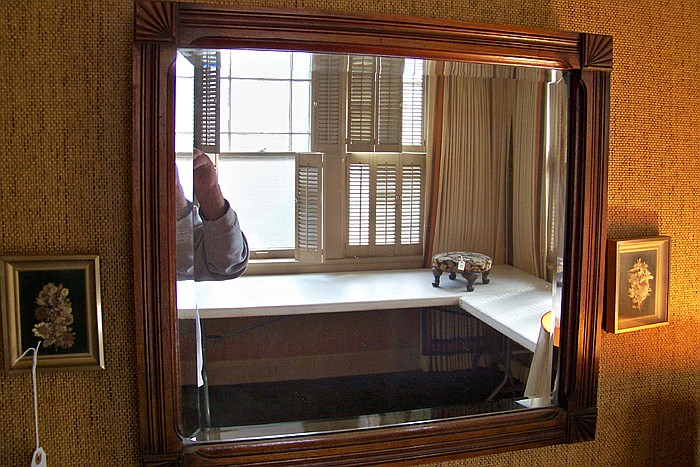 Beveled Wall Mirror in Wooden Frame