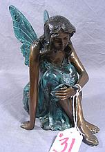 BRONZE SCULPTURE OF SEATED FAIRY HOLDING BUTTERFLY