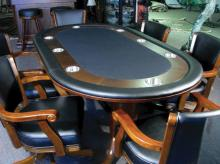 CARVED WOOD AND LEATHER GAME TABLE WITH SIX MATCHING CHAIRS