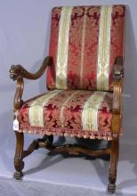 FINELY CARVED ANTIQUE WOOD AND UPHOLSTERED CHAIR