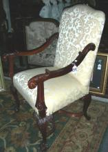 FINE HAND CARVE MAHOGANY AND UPHOLSTERED ARMCHAIR