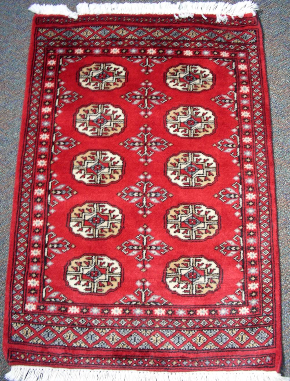 HAND KNOTTED BOKHARA AREA RUG