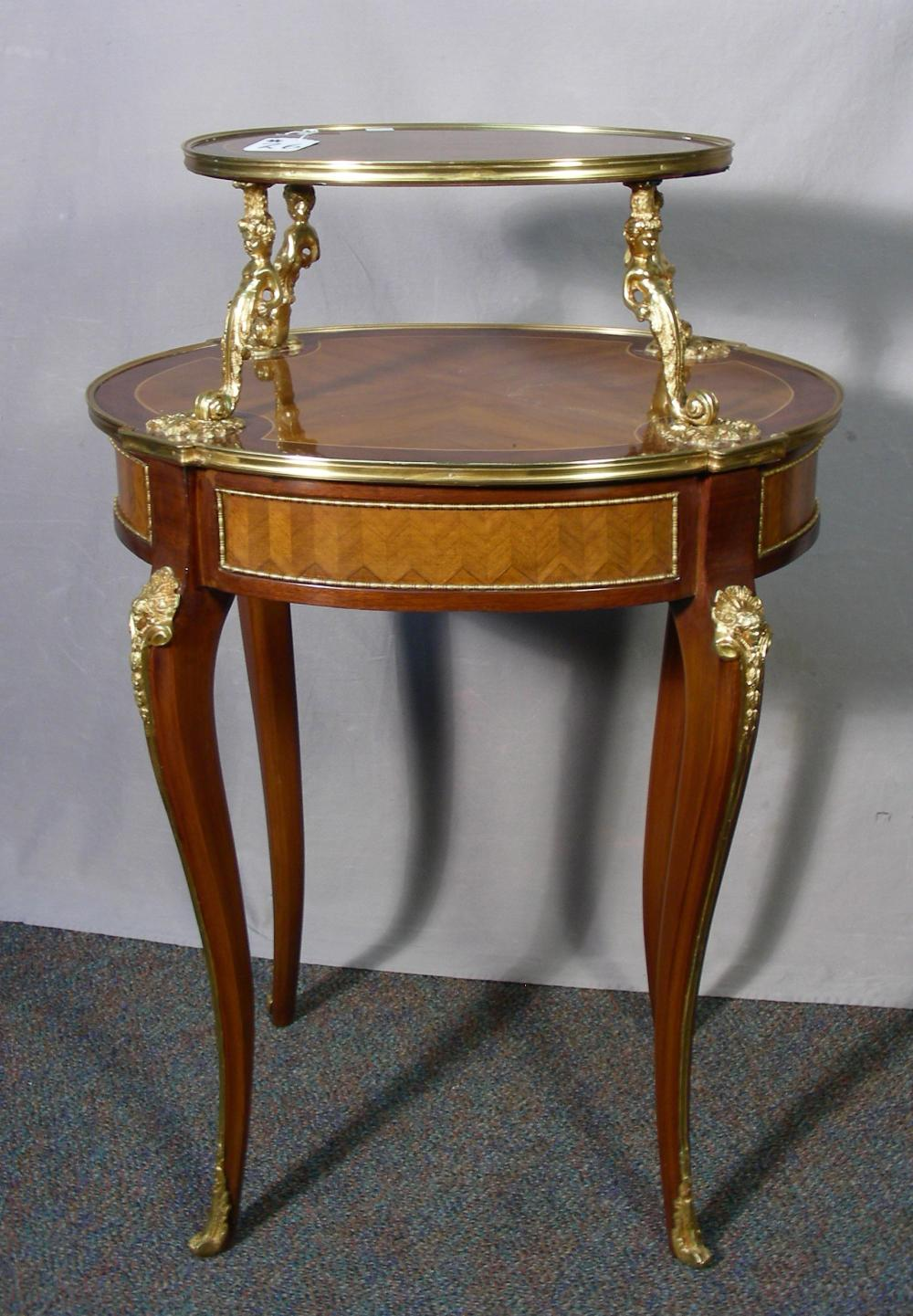 FRENCH INLAID DOUBLE TIERED TABLE WITH ORMOLU DECORATIONS