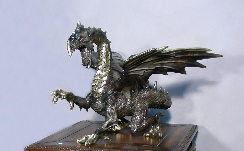 OUTSTANDING BRONZE SCULPTURE OF COILED DRAGON