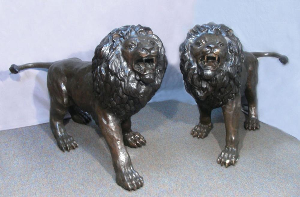 PAIR OUTSTANDING LIFESIZE BRONZE SCULPTURES OF STANDING LIONS