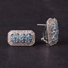 Earrings in White 14K gold with Diamonds and Topaz