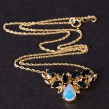 Ladies necklace in Yellow 14K Gold with diamonds, opal and saphires