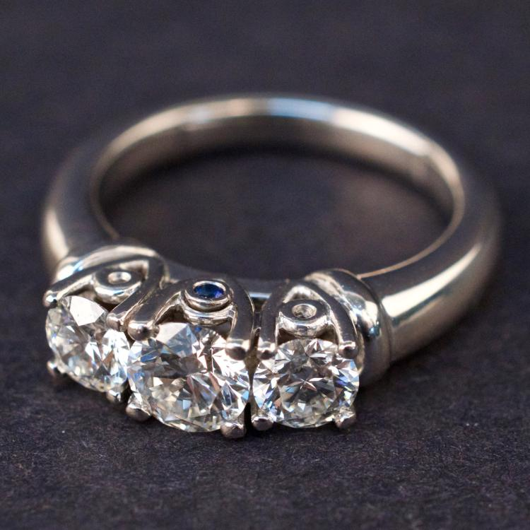 Ladies Ring in Platinum with Diamonds and Sapphire