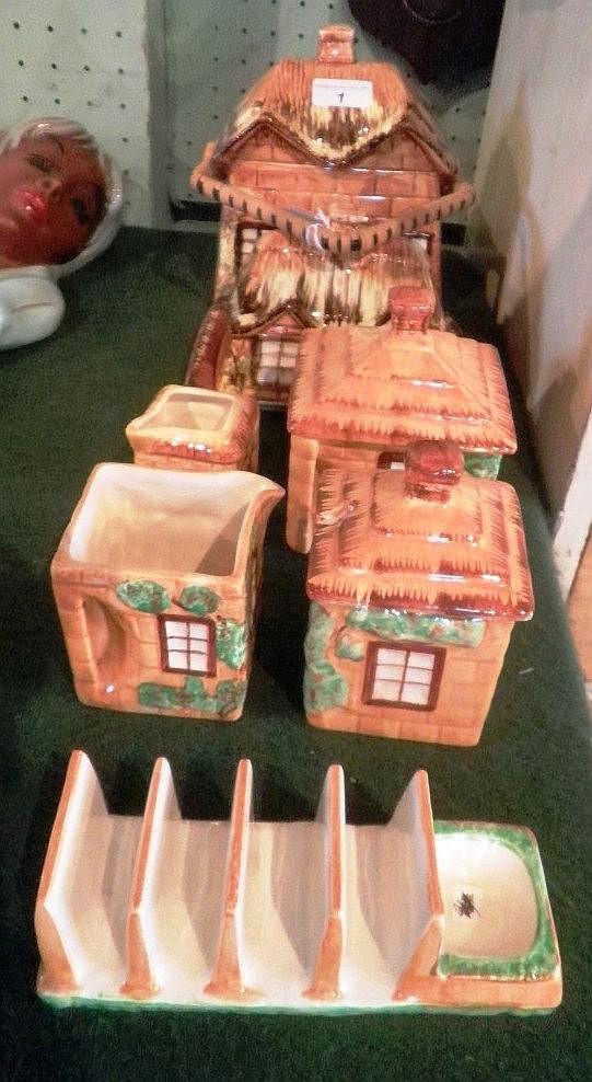 A harlequin set of cottageware, comprising: