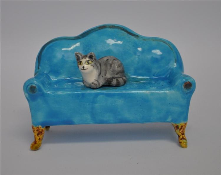 OTIS KIDWELL BURGER CAT ON A COUCH