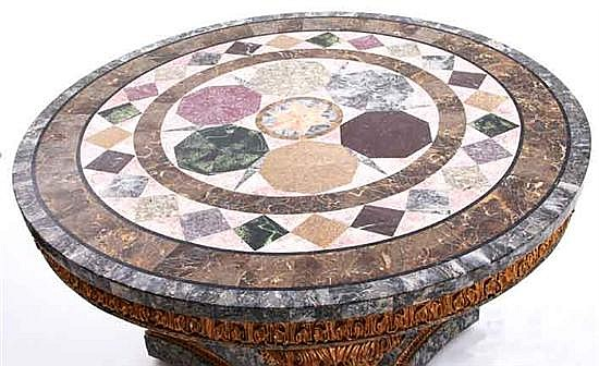 Continental carved giltwood center table with marble specimen top