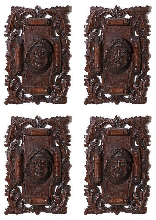 Set of four Continental carved oak wall plaques (4pcs)