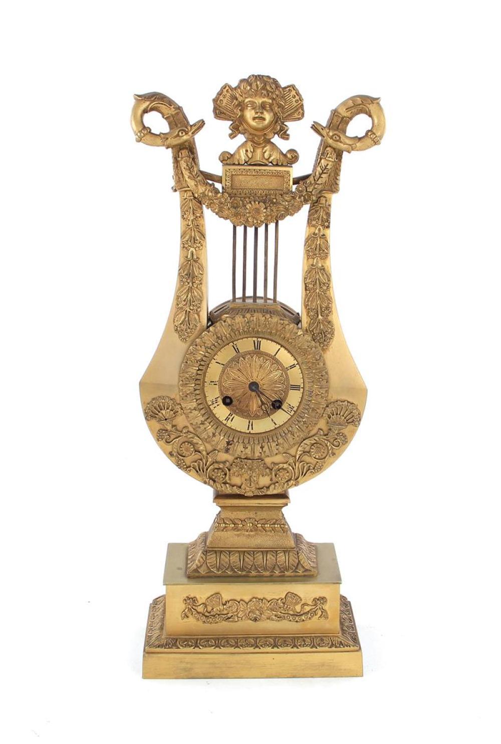 Late Empire bronze lyre mantel clock