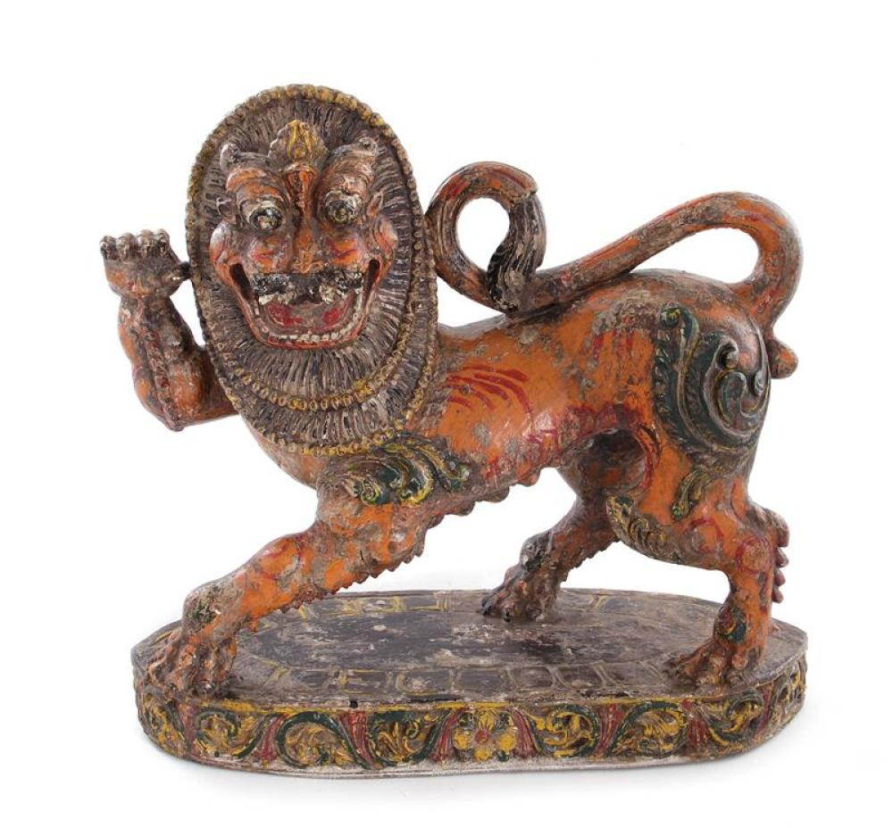 Southeast Asian polychrome carved wood lion figure