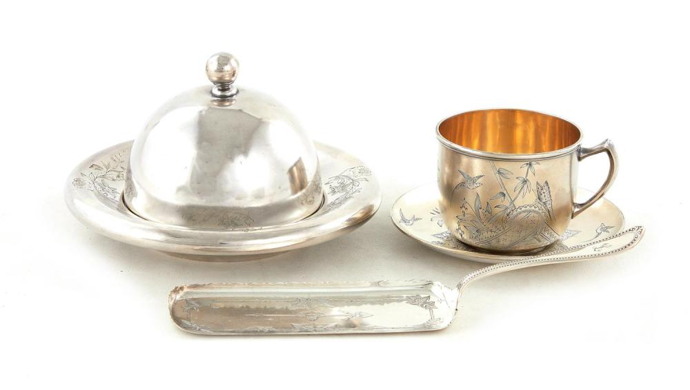 American silver butter dome, cup with saucer, and crumber (3pcs)