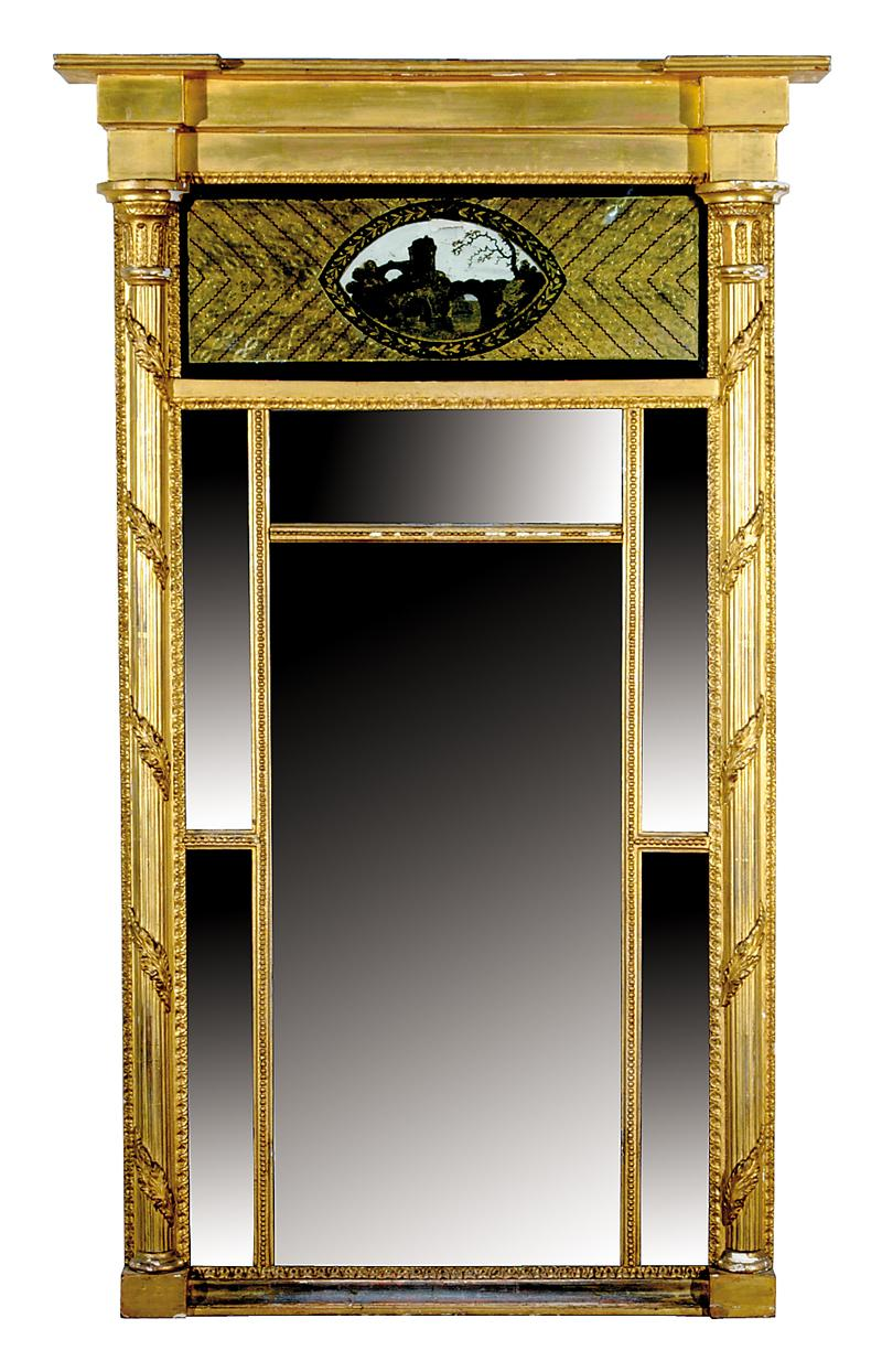 Fine carved giltwood and eglomise inset mirror
