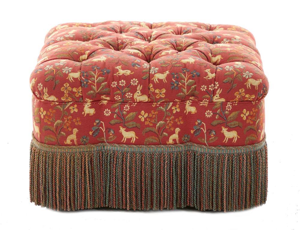 Fringe upholstered ottoman on casters