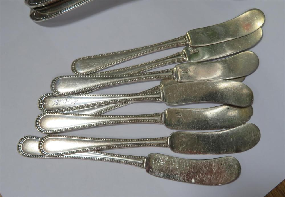 Southern coin silver tablespoons, and similar flat spreaders (12pcs)