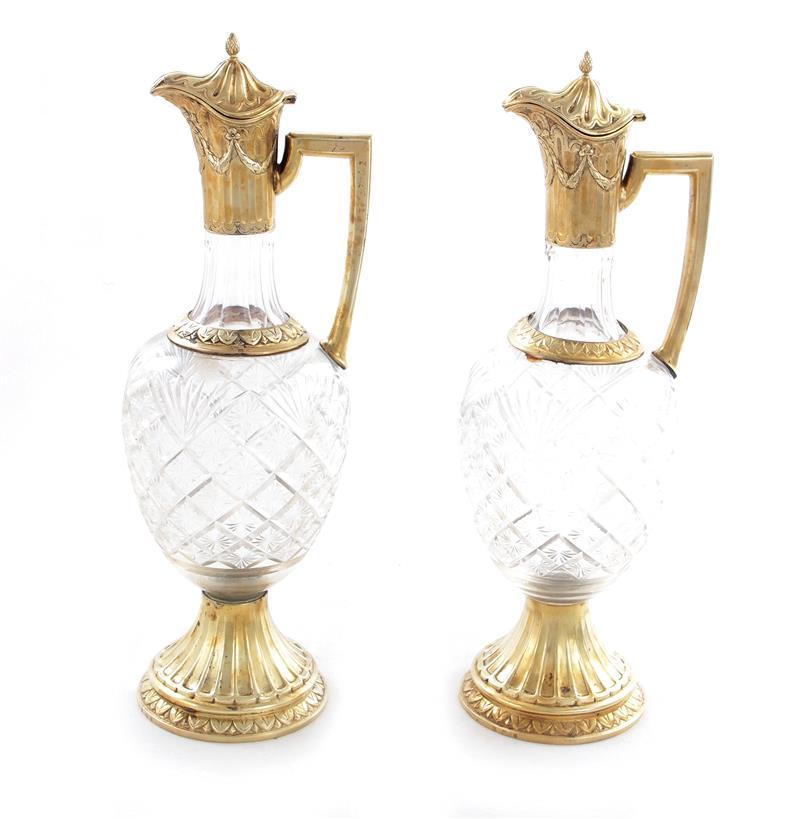 Pair Continental silver gilt-mounted crystal claret jugs (2pcs)