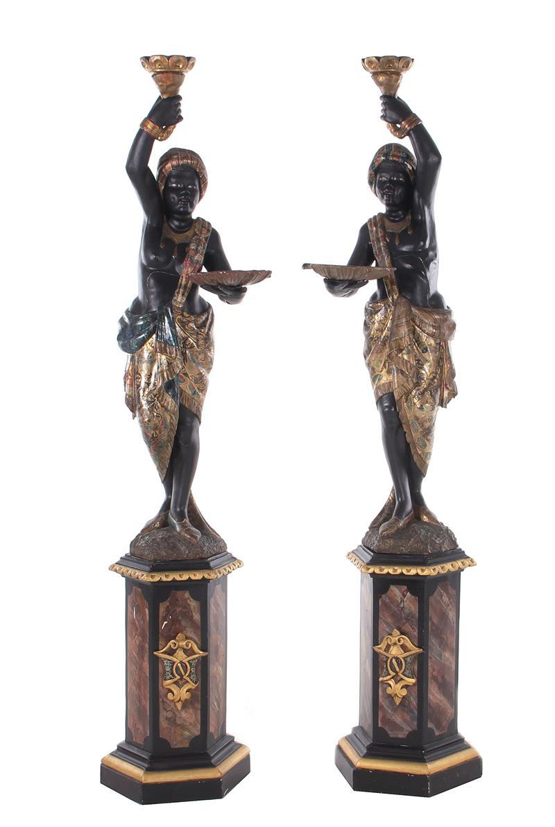 Pair Italian parcel-gilt and ebonized carved wood blackamoors (2pcs)