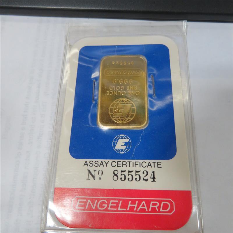Engelhard 1oz gold bar in assay