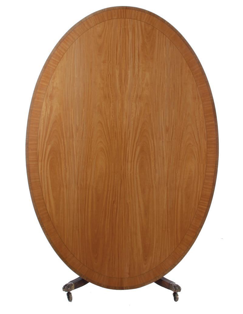 Georgian style inlaid satinwood oval breakfast table