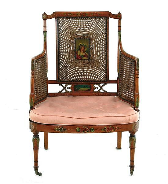 Edwardian polychrome-decorated and caned satinwood armchair
