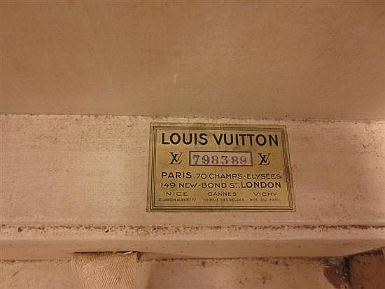 Vintage Louis Vuitton leather trunk on brass stand