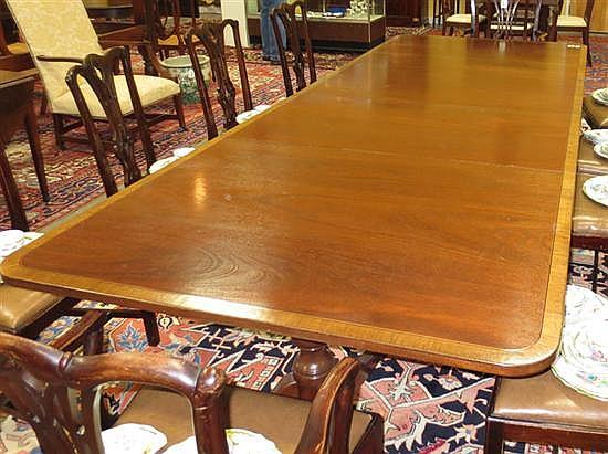 Sheraton style inlaid mahogany pedestal dining table