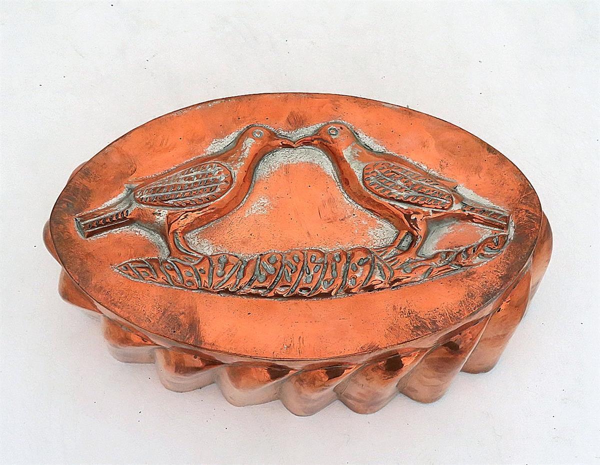 Rare tin-lined copper 'Love Birds' mould