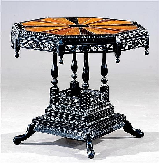 Aesthetic Movement carved mixed wood center table