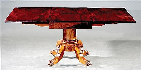 Classical carved mahogany drop-leaf dining table