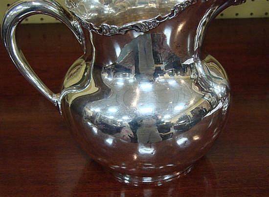 American sterling pitchers (2pcs)