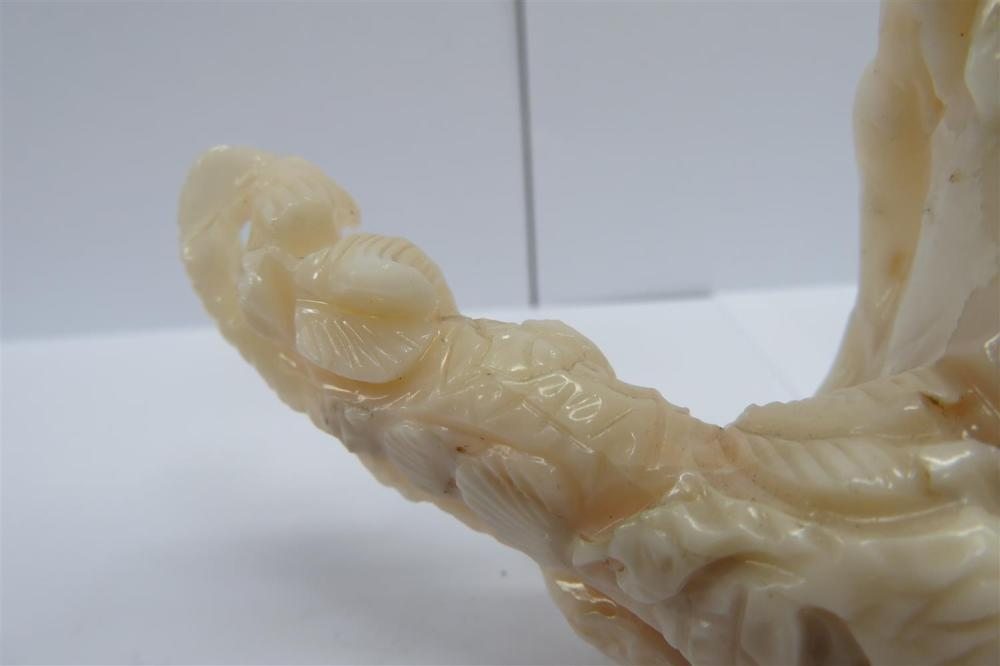 Chinese figural carved white coral branch
