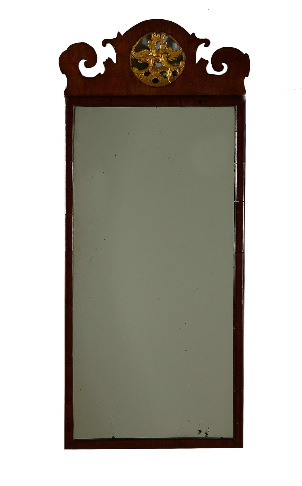 Georgian style parcel-gilt carved mahogany mirror