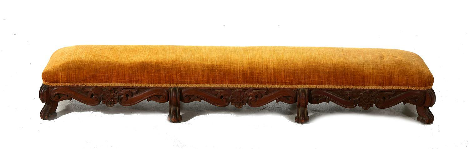 Continental upholstered and carved mahogany bench
