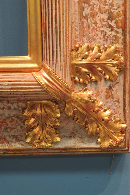 Carved giltwood frames (2pcs)