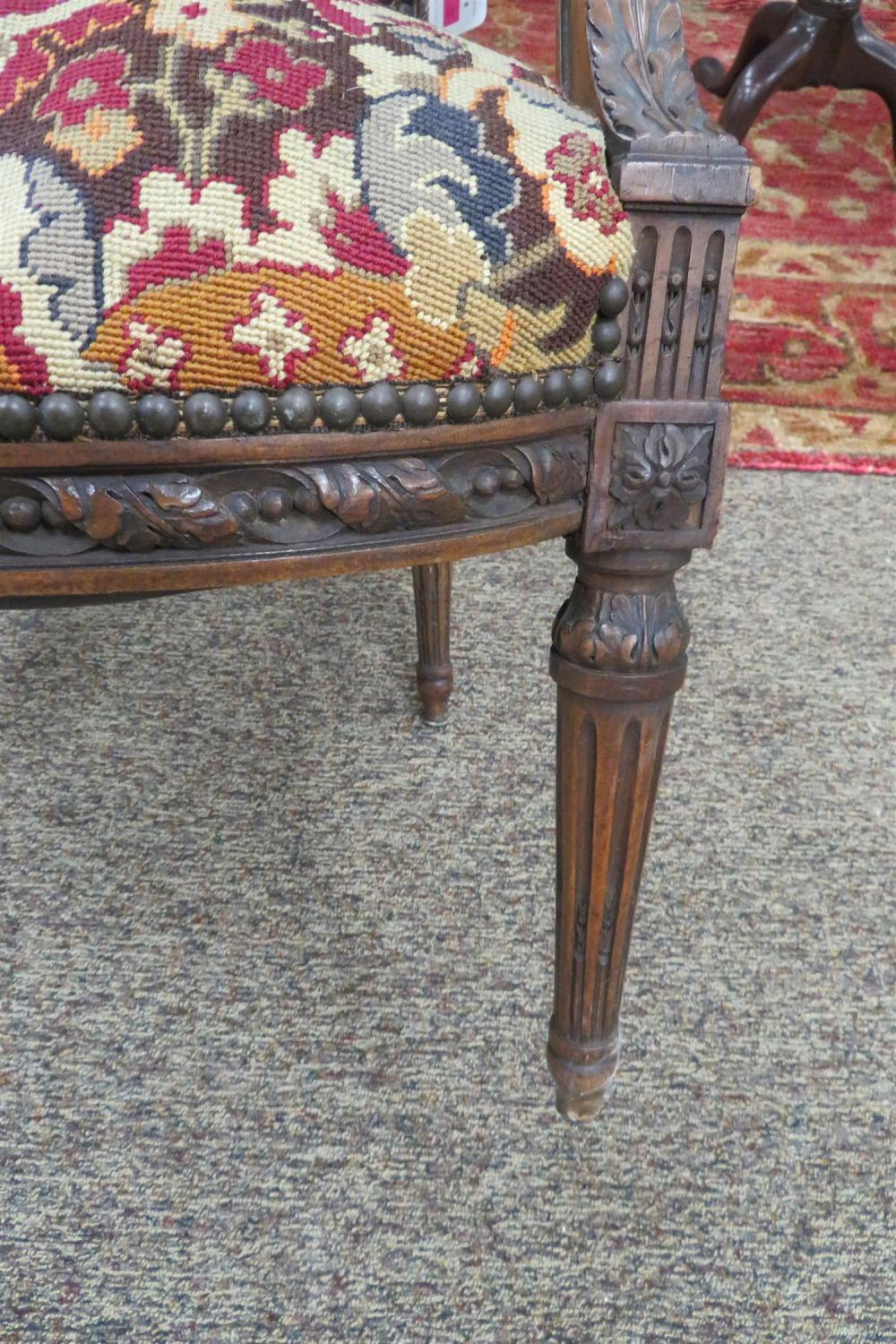 Louis XVI needlework and carved fruitwood armchair