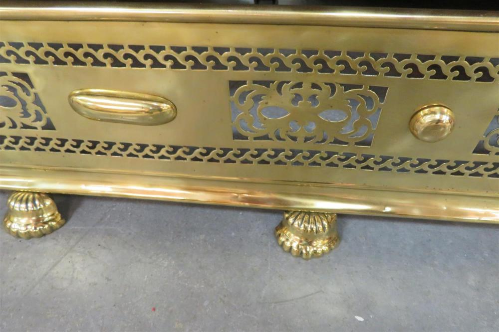 Pierced brass and paw-foot fire fender