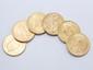 Lot en or composé de 5 pièces de 20 dollars et d'une pièce de 100 Francs.. Poids: 199 g.