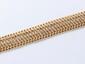 Bracelet ruban en or, mailles fantaisies guillochées agrémenté d'un fermoir à cliquet avec huit de sécurité.. Poids: 26.80 g. Dim: 20 x 2 cm.