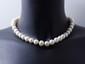 Collier composé d'un rang de perles de culture d'eau douce d'environ 10.7 à 12.3 mm, agrémenté d'un fermoir boule à cliquet en or 14k.. Poids brut: 74.50 g. Long: 45 cm.