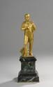 «Napoléon en pied près du code civil». Bronze à patine dorée. Socle en marbre vert. H totale: 19 cm. Epoque XIXème