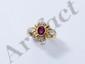 Bague en or, ornée d'un rubis ovale en serti clos, rehaussé de diamants brillantés. (égrisures). Poids brut: 6.90 g. TDD: 56.