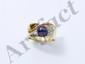 Bague en or, ornée d'une perle de culture grise d'environ 7.40 mm, rehaussée de diamants brillantés. . Poids brut: 8.90 g. TDD: 55.