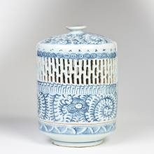 A BLUE AND WHITE OIL LAMP