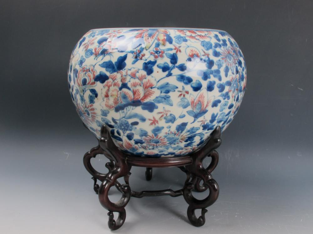 A Chinese Underglaze Blue And Copper Red Porcelain Jar with Wood Stand