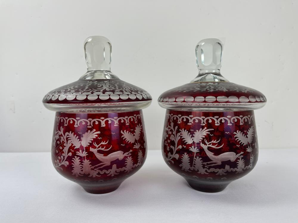 A Pair of ENGRAVED BOHEMIAN RUBY GLASS URNS
