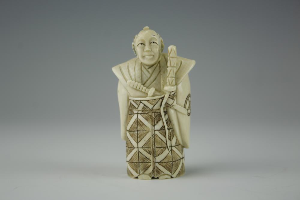 A Japanese Signed Carved Bone Netsuke Of A Samurai