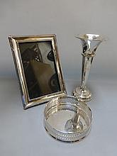 A silver photograph frame of plain form, a silver